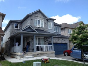 Exterior Painting - Milton, Ontario.  Ben Moore solid stains used on trim (fascia) and garage doors.  Ben Moore Regal Select (100% Acrylic latex - soft gloss) used on font door.
