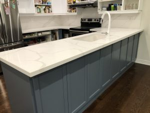 Spray Painted Kitchen Cabinets done in Normandy